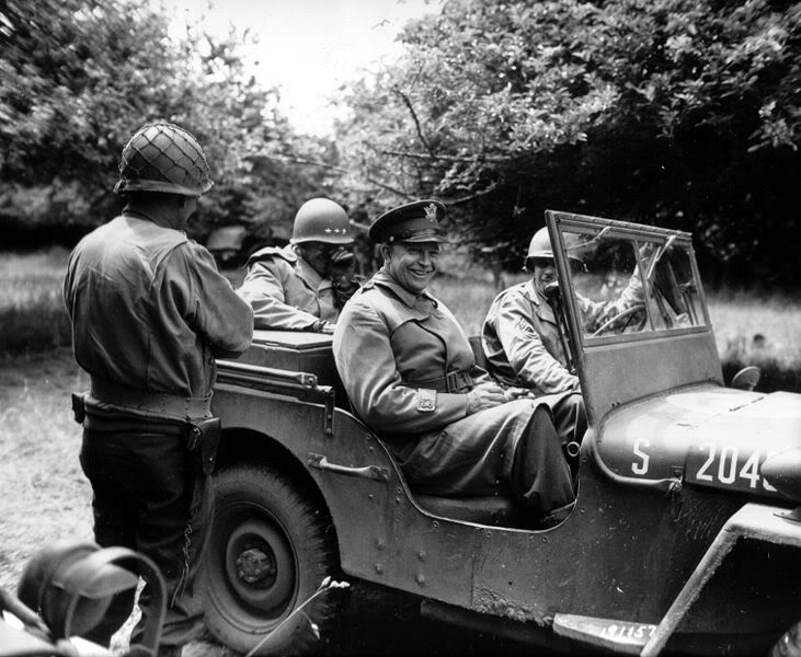 731px-Eisenhower_in_jeep_in_Normand
