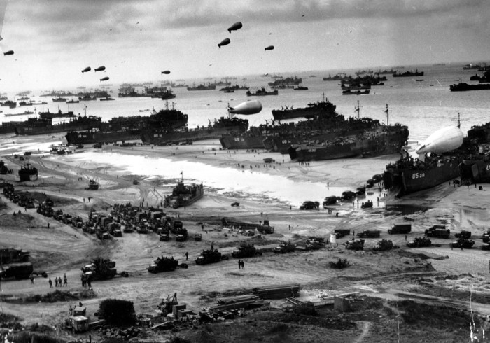 Allied soldiers, vehicles and equipment swarm onto the French shore during the Normandy landings, June 1944