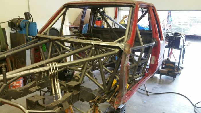 The cab being fitted to the chassis.